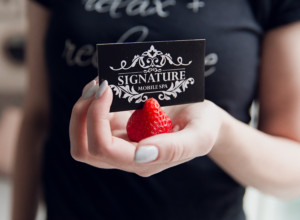 esthetician at a teen spa party holding a strawberry