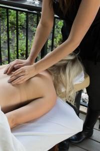 woman receiving a hot stone massage